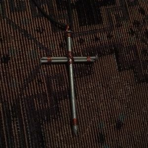 Cross made of nails necklace